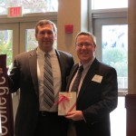 Scott Harris '95 and Michael '03 after receiving alumni awards